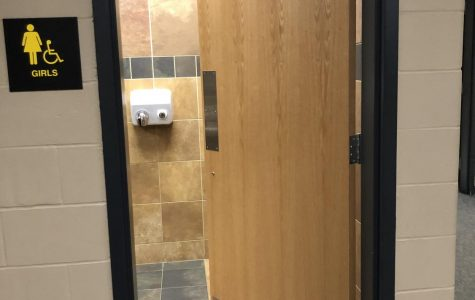 Bathroom door stops aim to curb vandalism