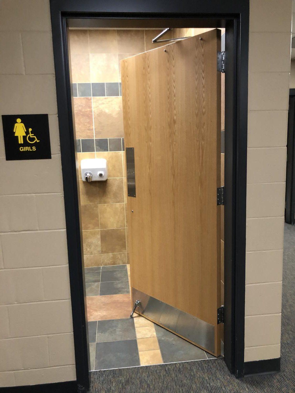 Bathroom door stops aim to curb vandalism