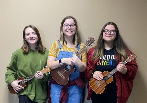 Elise Keuning, Sage Etling, and Lillian Gilroy with their instruments after a Ukulele Club meeting.  Alyssa Williams photo.
