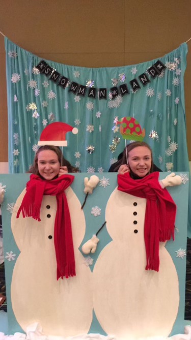 Senior Abby Wing with her sister at a holiday party. Photo courtesy of Abby Wing.