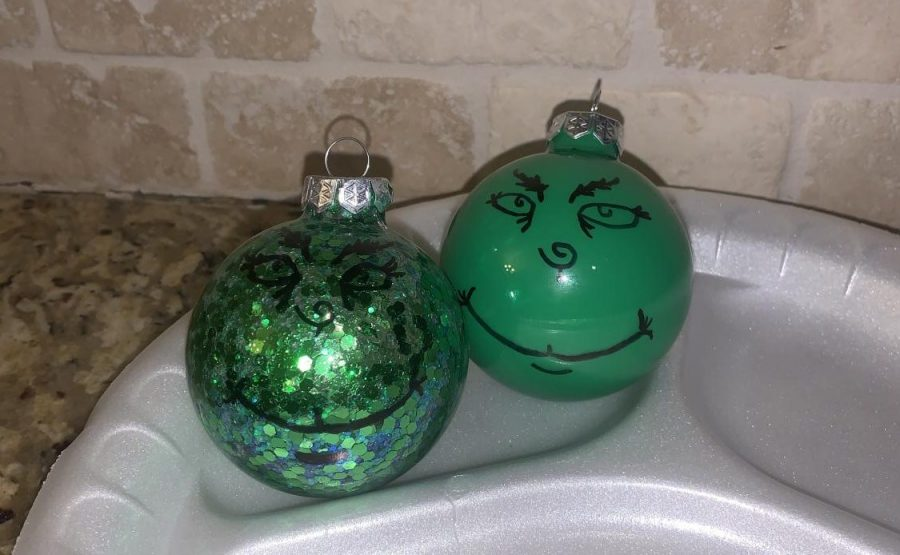 Glitter and Green paint Grinch Ornaments. Made by Carsyn Dasch.
